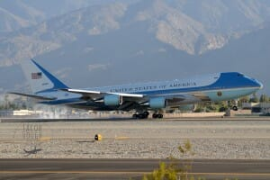 Air Force One touching down in golden light