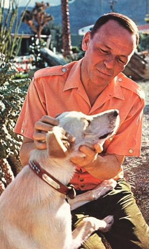 Frank Sinatra and his dog Ringo photographed in his Palm Springs home by John Bryson for the December 14, 1965