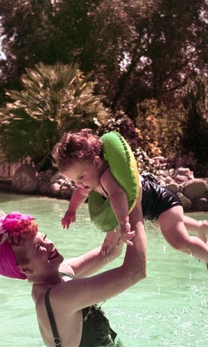 Lucille Ball with her daughter, Lucie, in swimming pool at her home in Palm Springs, August 1952.