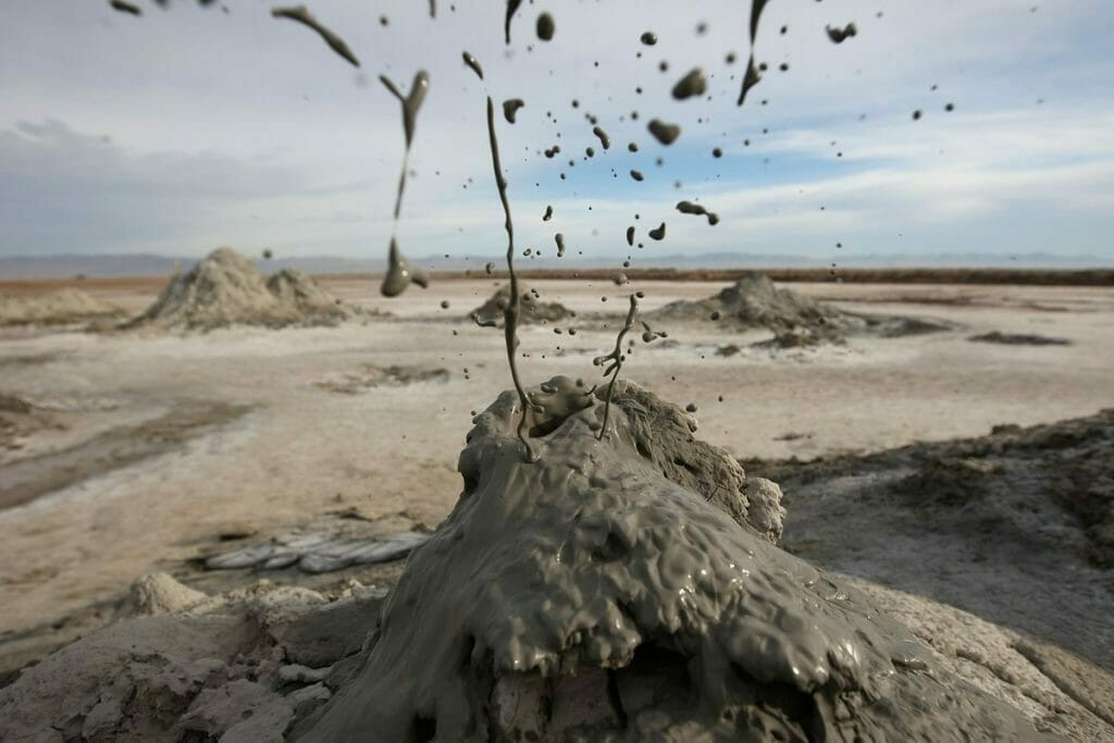 Mud flies as carbon dioxide gas from deep underground fissures escapes through geothermal mudpots, or mud volcanoes, over the southern San Andreas earthquake fault near the Salton Sea National Wildlife Refuge on January 16, 2010 near Calipatria, California. Photo by David McNew