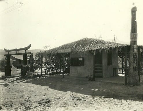 This Real Estate Office sat at the corner of Hwy 111 and Cathedral Canyon.  Note the totem pole on the right corner and the Chinese arch to the left.  Taco Bell now sits at this site.