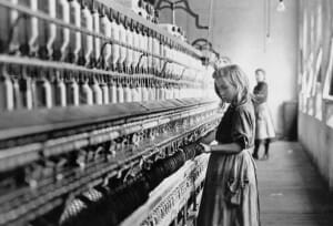 Little girl at work in cotton mill