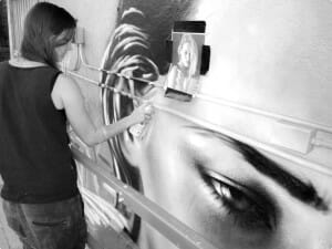 Chrisitna Angelina creating her newest mural at Bar in Downtown Palm Springs, Photo by Phillip Cariillo/Coachella Valley Productions