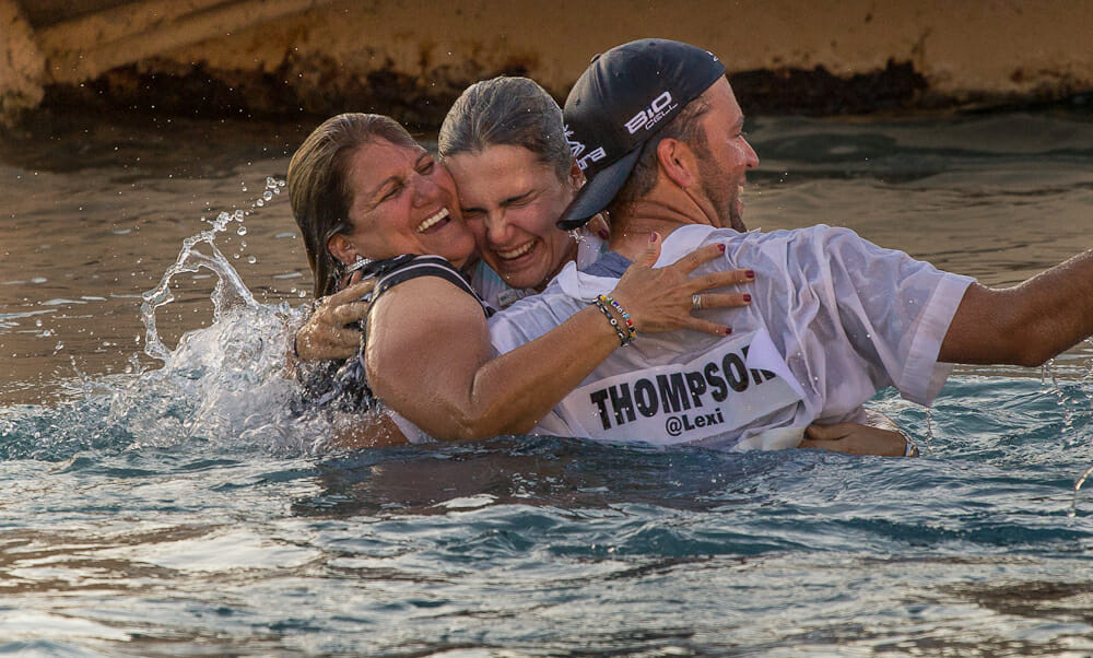 Lexi Thompson Embraces her mother and caddy in Poppies Pond.