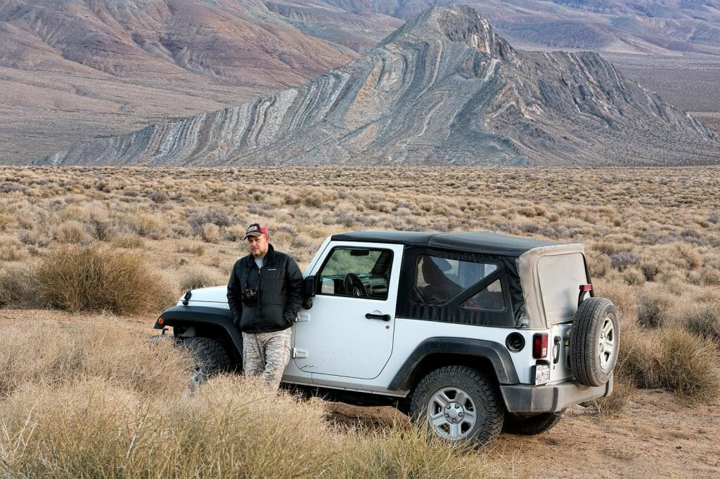 "Jim and ""White Lightening"" in  Butte Valley. Striped Butte can be seen in the background (Death Valley  National Park)"