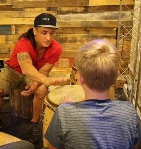 Daniel de los Reyes teaching a young student.