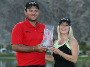 Patrick Reed shows off the trophy with wife Justine photo by SportingLIfe.com