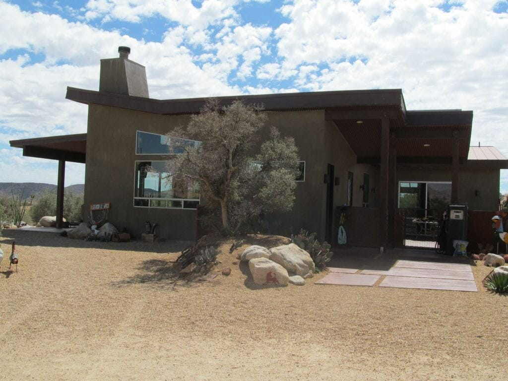 The first offering in the Pipes Canyon area of Pioneertown is Jackalope Junction, the home of Hector Alvarez and Jennifer Byrd. Designed by the owners, the home was built to reflect the style of local homestead cabins with some mid-century modern and industrial architectural designs thrown in.