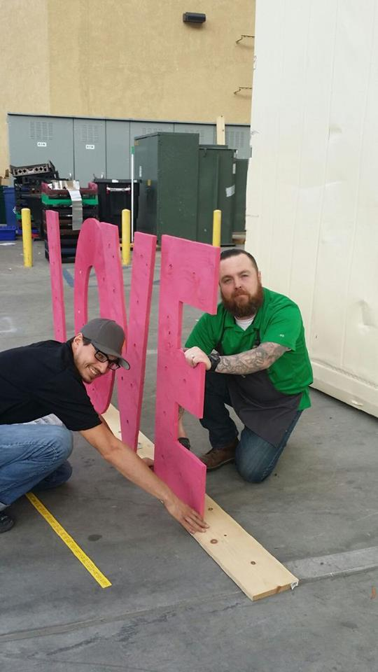 Whole Foods Store Leader Casey Coyle and Associate Jeff creating Valentine Décor!!