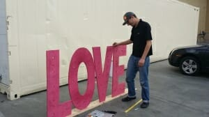 Love sign being built for the Whole Foods Market in Palm Desert to put shoppers in the mood by CoachellaValley.com