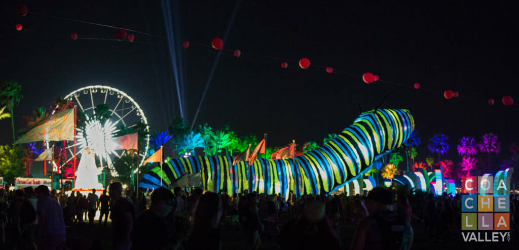 The crowd buzzes under the bright lights of animated artwork by Christopher Wayne Allwine/CoachellaValley.com