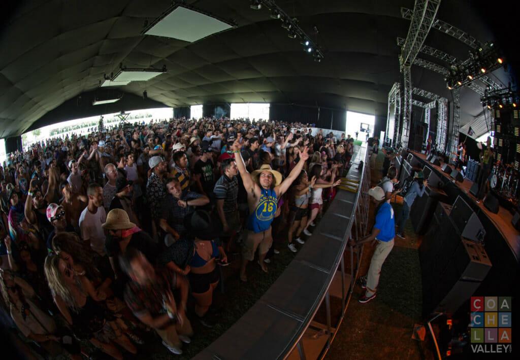 Crazy frenzy of head bobbing bodies all moving to the rhythm by Christopher Wayne Allwine/CoachellaValley.com