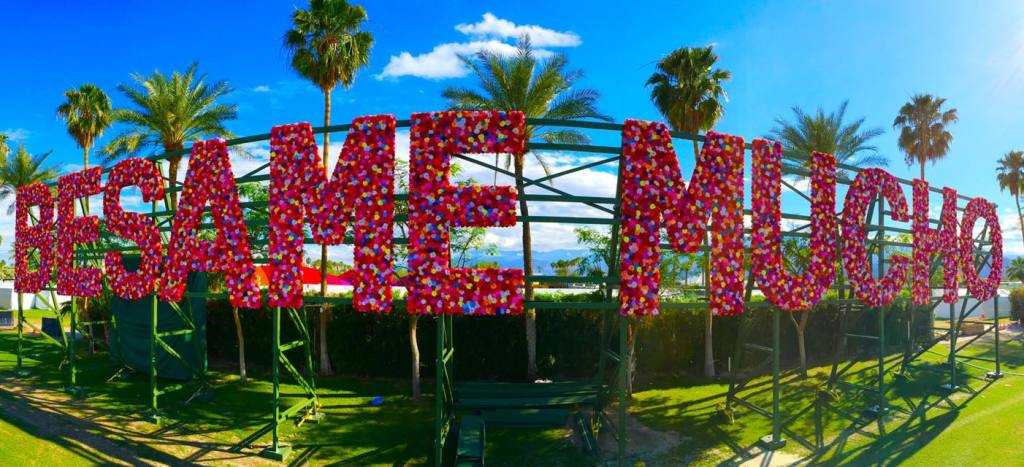 "giant flower-coated text ""Besame Mucho""... Spanish for ""Kiss me a lot"", causing a frenzy of Instagram-ready lovebirds. Photo by Benjamin Felix"