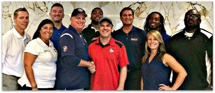 From left, Athletic Director Sean Tully, Director of Operations Cinthia Paiz, captain Jake Sheffield, head coach J David Miller, captain Gary Young, Coach Campbell, SVP Ron DiGrandi, captain Rashad Roberts, assistant Kelsey Stephenson, and captain Cedric Cox.