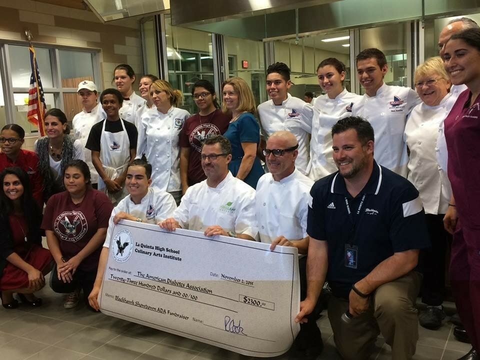 The LQHS Culinary ARTS Institute presents a check for the American Diabetes Foundation. Holding the check (l. to r.) are, student chef Ramesh Aguirre, New Leaf Catering's chef Scott Robertson, Masterchef Season 6 Finalist Stephen Lee, and Sean Webb