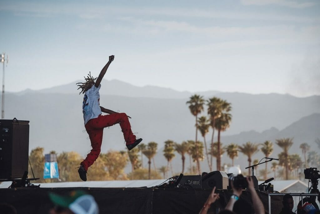 Jordan Terrell Carter, also known as Playboi Carti, performs with a beautiful desert landscape in the background. (Courtesy of Coachella)